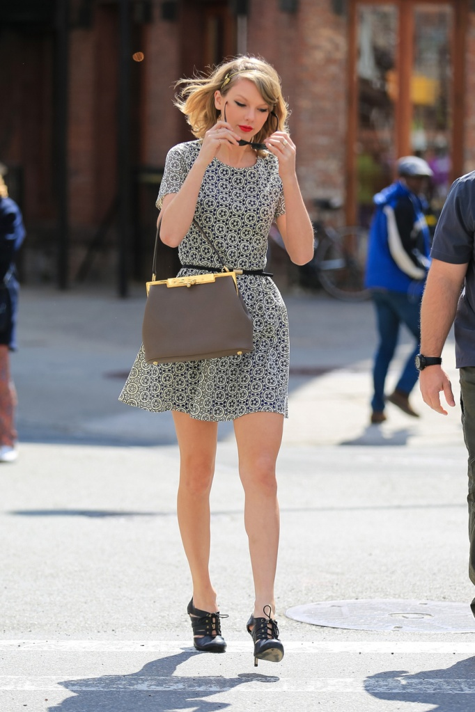 Taylor Swift makes quick stop at Le Pain Quotidien booth in Meatpacking District to buy some coffee in New York City